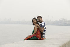 Indian young couple at Marine Drive Mumbai India. Royalty Free Stock Photography