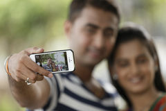 Indian young couple at Marine Drive Mumbai India clicking selfie. Royalty Free Stock Photography