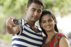 Indian young couple at Marine Drive Mumbai India clicking selfie. Stock Image
