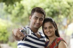 Indian young couple at Marine Drive Mumbai India clicking selfie. Royalty Free Stock Photos