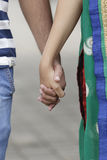 Indian young couple at Marine Drive Mumbai India holding hands. Royalty Free Stock Images