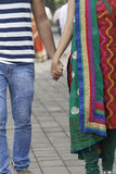 Indian young couple at Marine Drive Mumbai India holding hands. Royalty Free Stock Photo