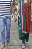 Indian young couple at Marine Drive Mumbai India holding hands. Royalty Free Stock Photos