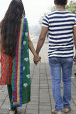 Indian young couple at Marine Drive Mumbai India holding hands. Stock Photo