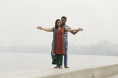 Indian young couple at Marine Drive Mumbai India holding hands. Royalty Free Stock Photography