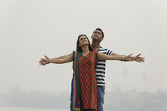 Indian young couple at Marine Drive Mumbai India holding hands. Stock Photos