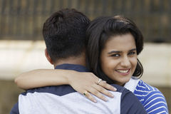 Indian young couple at Marine Drive Mumbai India hugging each other. Stock Photos