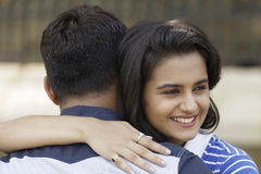 Indian young couple at Marine Drive Mumbai India hugging each other. Royalty Free Stock Photo