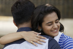 Indian young couple at Marine Drive Mumbai India hugging each other. Stock Photo