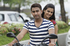 Indian young couple at Marine Drive Mumbai India riding motorbike. Royalty Free Stock Photo