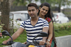 Indian young couple at Marine Drive Mumbai India riding motorbike. Royalty Free Stock Photos