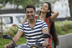 Indian young couple at Marine Drive Mumbai India riding motorbike. Stock Images