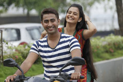 Indian young couple at Marine Drive Mumbai India riding motorbike. Stock Photos