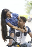 Indian young couple at Marine Drive Mumbai India riding motorbike. Royalty Free Stock Image