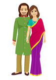 Indian young couple in traditional clothing standing  over white background. Indian young couple in traditional clothing standing  over a white background Stock Image