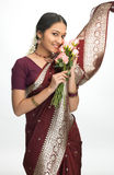 Indian young girl with pink flowers Stock Images