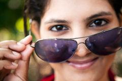 Indian young girl with sunglasses Stock Photography