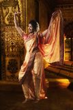 Indian young lady performing traditional dance. Indian young lady performing traditional folk dance of Maharashtra called as Lavani stock image
