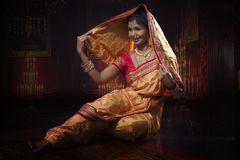 Indian young lady performing traditional dance royalty free stock photography