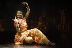 Indian young lady performing traditional dance. Indian young lady performing traditional folk dance of Maharashtra called as Lavani royalty free stock image