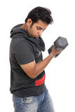 Indian young man curling a dumbbell Stock Image