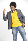 Indian Young Man dancing with headphone Royalty Free Stock Photography