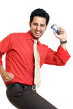 Indian young man dancing with mobile Royalty Free Stock Image