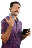 Indian young man listening to music Stock Photo