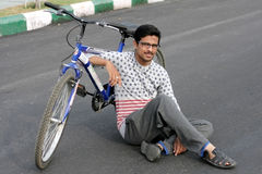 Indian young man member Hyderabad Bicycling Club rest  on raahgiri day Royalty Free Stock Image