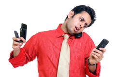 Indian young man with mobile phones Stock Photos