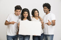 Indian young people holding blank white board Stock Photos