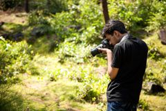 Indian young photographer Royalty Free Stock Image