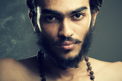 Indian young sadhu looking Stock Photo