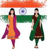 Indian young woman with flag background. Beautiful indian young woman in colorful salwar kameez ,with a grunge Indian flag background-- Highly detailed and no Royalty Free Stock Photography