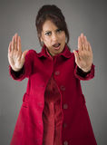 Indian young woman making stop gesture sign from both hands Stock Image