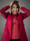 Indian young woman pulling her hair and screaming in frustration Royalty Free Stock Photos