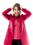 Indian young woman pulling her hair and screaming in frustration Royalty Free Stock Images