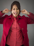 Indian young woman shouting in frustration. Adult indian woman in studio isolated on grey background Royalty Free Stock Photography