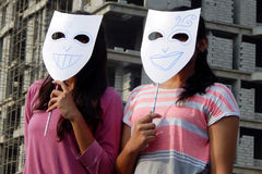 Indian young women wear masks. Indian young adult  wear theatre masks during raahgiri open road event  on March 27,2016 in Hyderabad,India Royalty Free Stock Photos