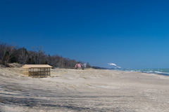 Indiana Dunes National Lakeshore. An empty beach house sits on the shore of Lake Michigan, with the factories of Gary, Indiana in the distance Stock Photography