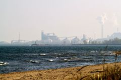 Distant view of industrial area of Michigan City, Indiana. Indiana Dunes National Lakeshore, with view of industrial area of Michigan City in distance royalty free stock images