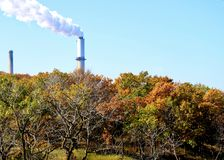 Smoke stack in Michigan City, seen from Indiana Dunes stock images