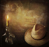 Indiana Jones adventure. Grunge background Indiana Jones like, hut, candle, skull and treasure chest royalty free stock images