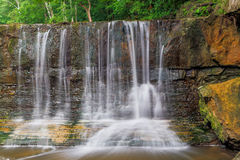 Indiana's Anderson Falls. A small section of Anderson Falls, near Columbus, Indiana is seen here with a light flow in the middle of summer Royalty Free Stock Photos