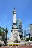 Indiana Soldiers' and Sailors' Monument, Statehouse in backgroun. INDIANAPOLIS - JUNE 16:  The Indiana Soldiers' and Sailors' Monument shown June 16, 2014, is at Royalty Free Stock Photography