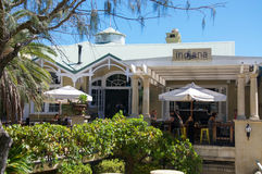Indiana Tea House at Cottesloe Beach. COTTESLOE,WA,AUSTRALIA-MARCH 12,2016: Indiana Tea House landmark restaurant with outdoor umbrella'd seating with people at stock image