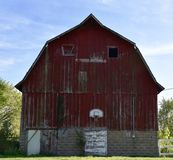 An Indiana Teadition. This is a picture of an iconic image of basketball backboards and hoops attached to big red barns that seem so prevalent in rural Indiana royalty free stock photography