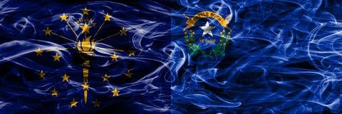 Indiana vs Nevada pojęcia dymu kolorowe flagi umieszczająca strona strona - obok - obraz royalty free