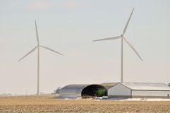 Indiana Wind Turbine over farm equipment. Indiana Wind Turbine over farming equipment Stock Photo