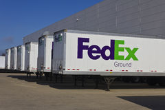 Indianapolis - Circa December 2015: Federal Express Trucks in Loading Dock. S. FedEx is a global courier delivery services company I Royalty Free Stock Image